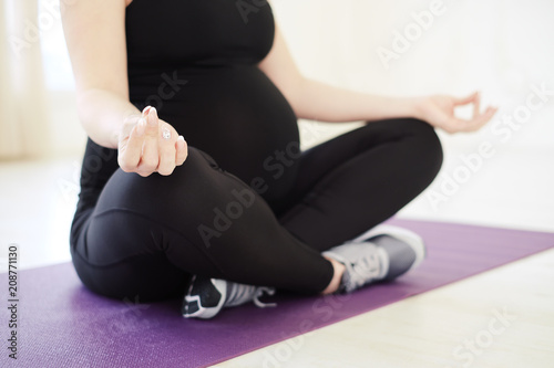 Fotobehang School de yoga Close up view of young pregnant woman doing morning yoga exercis