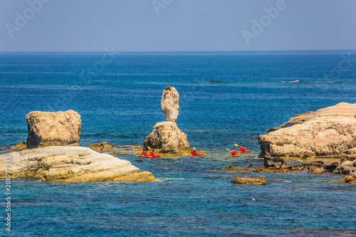Fotobehang Cyprus Group of oarsmen on the red canoe