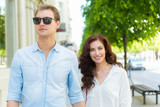 Young couple walking in a city center - 208781708