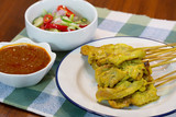 Pork Satay with peanut sauce and vegetables salad sauce on napery cloth