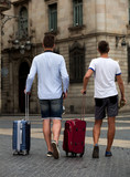 Rear view of two guys with luggage - 208784995
