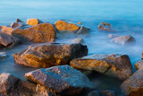 Sea rocks in haze at sunset - 208795158
