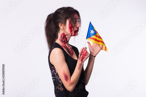 The victim woman holds the flag of Catalonia. Protest against terrorism.