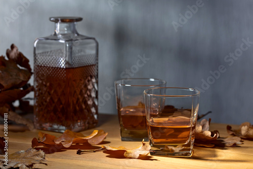 Whiskey on a old wooden table. - 208804181