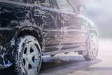 .Washing the black car. - 208810307