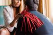 Leinwanddruck Bild - Woman put whip on man shoulder