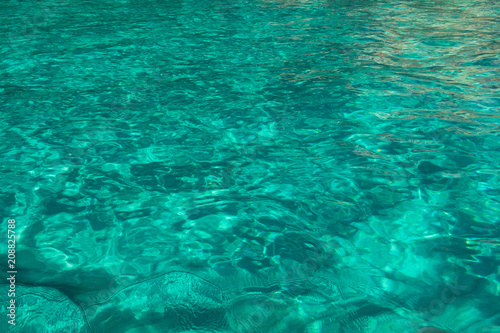 Turquoise colored sea water background