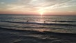 Paddle board surfing at sunset. SUP on ocean aerial footage