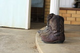 Womens leather cowboy boots removed outside after used on the farm in Tamworth, New South Wales, rural Australia - 208835989