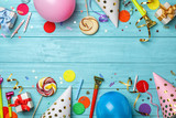 Flat lay composition with birthday party items on wooden background