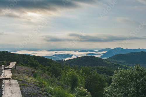 Aluminium Bleke violet Sunrise over misty forested mountains, Velebit mountain national park in Croatia