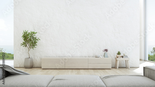 Leinwandbild Motiv Sea view living room of luxury summer beach house with TV stand and wooden cabinet. Empty rough white concrete wall background in vacation home or holiday villa. Hotel interior 3d illustration.