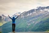 Tourist woman enjoying mountains landscape in Norway.