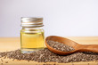 Leinwanddruck Bild - Close up a Chia essential oil and seeds in wooden spoon , a superfood and rich of nutrient an antioxidant