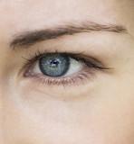 Beautiful blue eye girl close-up. macro portrait of female face.