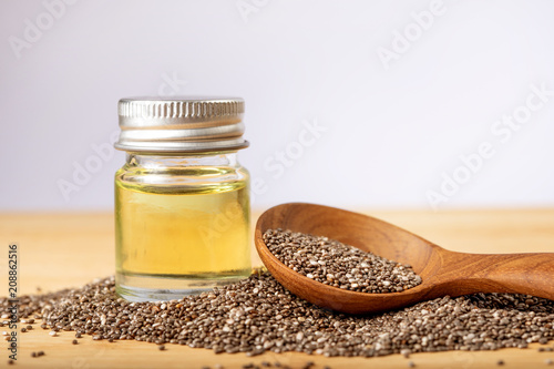 Leinwanddruck Bild Close up a Chia essential oil and seeds in wooden spoon , a superfood and rich of nutrient an antioxidant
