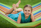 Young girl relaxing on the hammock in garden. - 208866541
