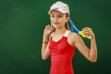 Tennis young girl player on court. - 208868918