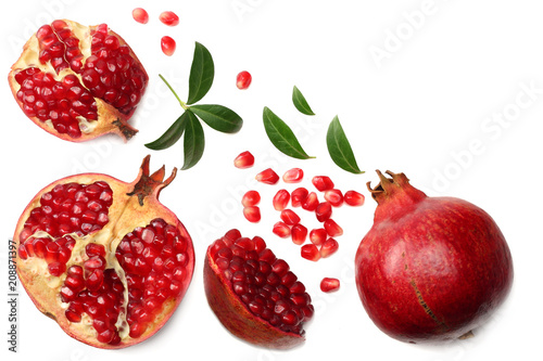 pomegranate fruit with green leaves isolated on a white background top view