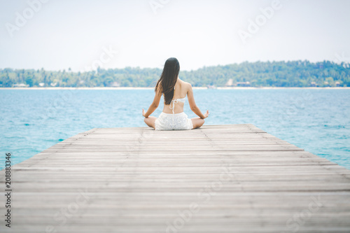 Fototapeta Woman meditation on bridge