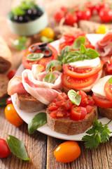 assorted bruschetta with tomato, mozzarella, olive
