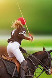 Polo woman player is riding on a horse. - 208891311