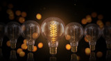 Vintage light bulbs on dark background. - 208892557