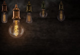 Vintage light bulbs on dark background. - 208892568