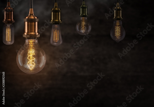 Vintage light bulbs on dark background.