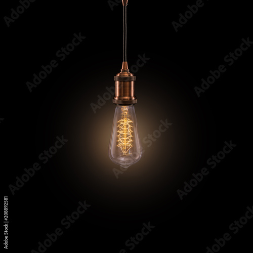 Vintage light bulb on dark background.