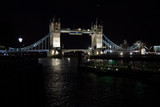 Tower bridge with night illumination in London, United Kingdom. Bridge over Thames river with dark water with nice architecture. Structure and design. Wanderlust and vacation concept