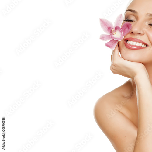beautiful young woman hold a orchid on white background - 208900588