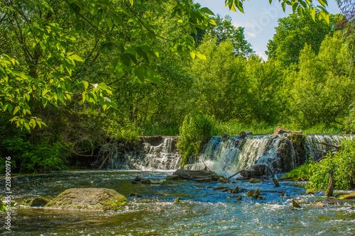 Plexiglas Groene small waterfall in forest nature landscape