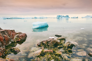 Icebergs on the shore of Atlantic ocean, western Greenland