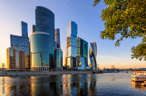 Leinwanddruck Bild Skyscrapers of Moscow City business center and Moscow river in Moscow at sunset, Russia