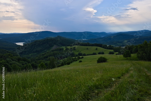 Mountain view over the Carpathian hills in the Poloniny national park in Slovakia with a view on the Starina reservoir - 208916966