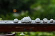 Pieces of ice on the railing after hailstorm