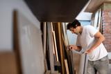 Carpenter in his workshop - 208920968