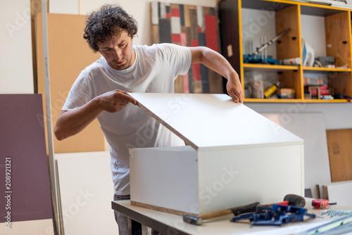 Foto Murales Carpenter making custom furniture