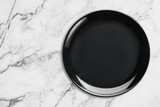 Black Empty Ceramic Plate on marble table, top view. - 208934555
