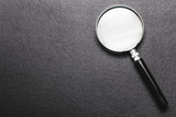 magnifying glass on  black texture  background. - 208935157