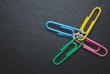 paper clips on black background, teamwork and success concept. - 208935778