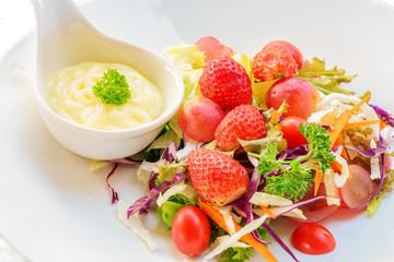 closeup of firuits salad and salad dressing in spoon © paisan1leo