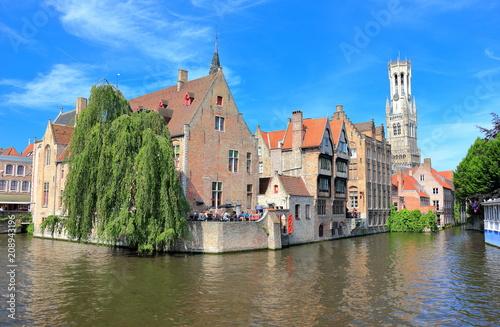 Fotobehang Brugge The Rozenhoedkaai (canal) in Bruges with the belfry in the background. Belgium, Europe.