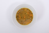 Lentil soup with carrot on a white