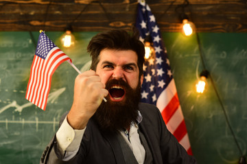 angry businessman with american flag close up.