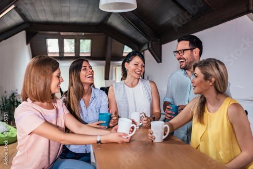 Coworkers having a coffee break. - 208955751