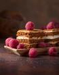 Leinwanddruck Bild - Layered honey cake with cream and raspberries.