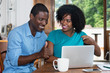 Successful african american love couple with laptop - 208957947