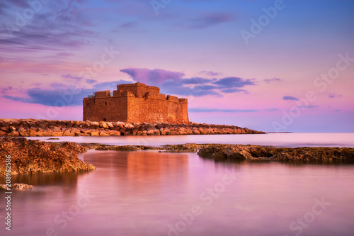 Fotobehang Cyprus Pafos Harbour Castle in Pathos, Cyprus, on a sunset